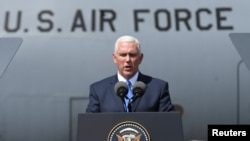 FILE - U.S. Vice President Mike Pence delivers a speech during a meeting with U.S. troops taking part in NATO led joint military exercises Noble Partner 2017 at the Vaziani military base near Tbilisi, Georgia, Aug. 1, 2017.