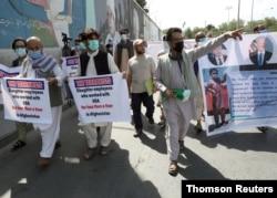 FILE PHOTO: Former Afghan interpreters who worked with U.S. troops in Afghanistan demonstrate in Kabul
