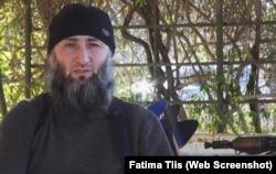 A screenshot depicting Islam Atabiev, aka Abu Jihad, from a YouTube IS propaganda video.