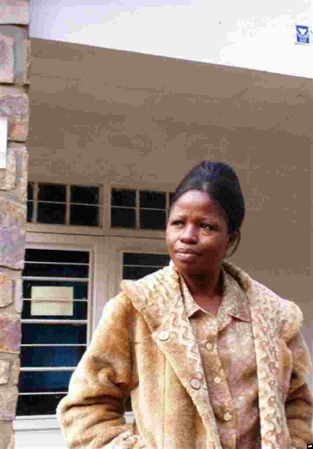 ** CORRECTS DAY IN DATE ** Cecile Mulolo a psychologist stands outside the Panzi General Hospital for rape victims in Eastern Congo close to the town of Bukavu, Democratic Republic of Congo on Saturday, June. 11, 2005. In Congo, for those who manage to su
