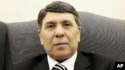 ຮູບພາບຂອງຊາຍຄົນນຶ່ງທີ່ສະແດງໃຫ້ເຫັນໃນວີດີໂອທີ່ອ້າງຕົນວ່າ ຕົນຊື່ Abdo Husameddine ແລະເປັນ ຮອງລັດຖະມົນຕີນໍ້າມັນຊີເຣຍນັ້ນ. ວັນທີ 8 ມີນາ 2012.
