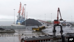FILE - In this July 24, 2016, file photo, coal brought from Siberia is seen awaiting loading onto a ship bound for China in the North Korean special economic zone of Rason. China has long been the North Korea's main trading partner and diplomatic protector. But Kim Jong Un's nuclear and missile tests have alienated Chinese leaders, who supported U.N. sanctions.