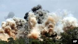 나토의 공습을 받는 트리폴리 인근 도시