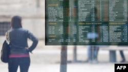 Monitor pokazuje stanje na berzi u Milanu, 9. novembra 2011.
