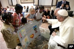 Pope Francis meets refugee children in St. John Lateran Basilica in Rome.