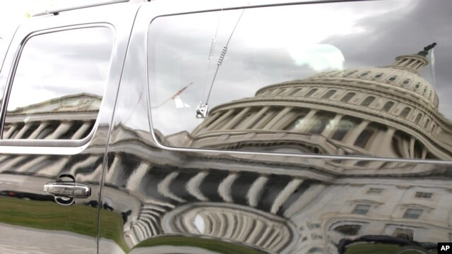 The U.S. Capitol is reflected in an SUV parked outside the Capitol in Washington, September 28, 2013.