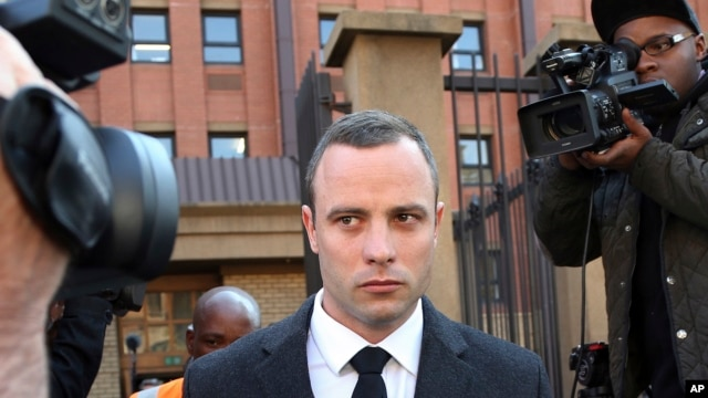 FILE - Oscar Pistorius leaves the high court in Pretoria, South Africa.