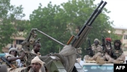 (FILES) A picture taken on June 21, 2008 shows Chadian soldiers parading in N'djamena.Rebels waging an offensive in the Central African Republic seized Kaga-Bandoro, another major town, on Dec. 25, 2012.