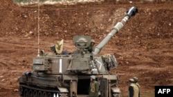Một khẩu trọng pháo di động của Israel được bố trí gần biên giới với Syria trong vùng Cao Nguyên Golan Israel chiếm đóng, 27/1/15