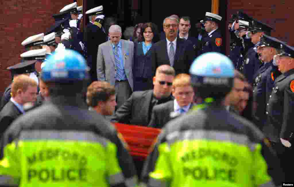 Patty Campbell watches as the casket containing the body of her daughter Krystle, one of the victims of the marathon bombing, is carried out of St. Joseph Church in Medford, Massachusetts, April 22, 2013.