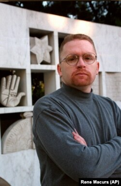 """Tom """"T.J."""" Leyden is seen in front of the Wall of Remembrance at the Simon Weisenthal Museum of Tolerance in Los Angeles, Tuesday, Dec. 9, 1997. In the early 1980s Leyden was a founder-recruiter for one of California's deadliest skinhead groups."""