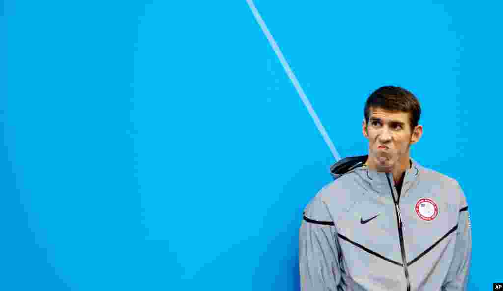 United States' Michael Phelps waits to receive his silver medal for the men's 200-meter butterfly swimming final. Phelps broke the record for career olympic medals (19) today when he won gold in the 4x200-meter relay.