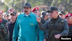 Venezuelan President Nicolas Maduro speaks with senior military officials during a military exercise in Valencia, Venezuela, Jan. 27, 2019.