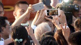 Indian Prime Minister Narendra Modi takes a selfie using a cell phone.