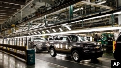 FILE - SUV'S near the final process on the assembly line at the General Motors plant in Arlington, Texas, July 14, 2015.