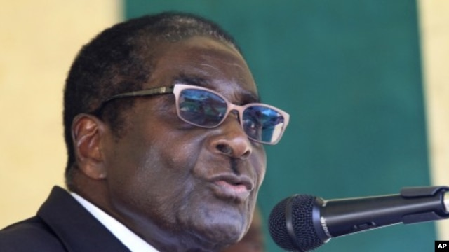 Zimbabwe's President Robert Mugabe speaks during a visit to Mimosa Platinum mine about 400km (249 miles) south of the capital Harare, February 16, 2012.