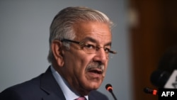 FILE - Pakistani Foreign Minister Khawaja Asif briefs the media at the end of a three-day conference in Islamabad, Pakistan, Sep. 7, 2017.
