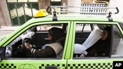 A female taxi driver is seen fetching a passenger in Tehran, Iran, August 21, 2011. About 500 female drivers make up the Women's Taxi company which serves only female passengers.