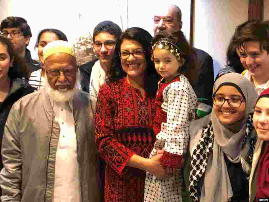Congresswoman Rashida Tlaib (D-MI), the first Palestinian-American elected to the House, poses with supporters outside her office at the Longworth House Office Building (LHOB), in Washington, D.C., Jan. 3, 2019.