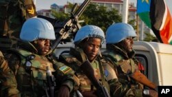FILE -- U.N. peacekeepers from Rwanda wait to escort members of the U.N. Security Council as they arrive at the airport in Juba, South Sudan, Sept. 2, 2016. The envoys arrived Friday to press the government to allow another 4,000 peacekeepers into South Sudan.