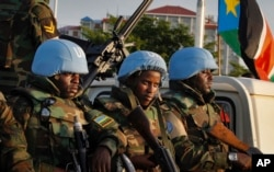 FILE - U.N. peacekeepers from Rwanda wait to escort members of the U.N. Security Council as they arrive at the airport in Juba, South Sudan, Sept. 2, 2016.