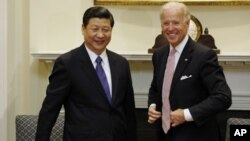 U.S. Vice President Joseph Biden (r) and China's Vice President Xi Jinping in the Roosevelt Room at the White House in Washington, February 14, 2012.