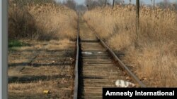 Many Migrants, refugees and asylum seekers follow railroad tracks when they reach the Balkan countries because they lead to towns and cities. Amnesty International says at least 30 have been killed by passing trains over recent months. (Credit: Amnesty International)