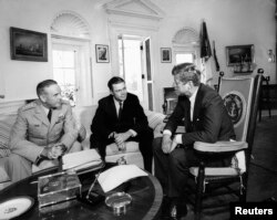 President Kennedy, right, meets with Secretary of Defense Robert S. McNamara and Chairman of the Joint Chiefs of Staff General Maxwell D. Taylor, left, in the Oval Office at the White House on Oct. 2, 1963.