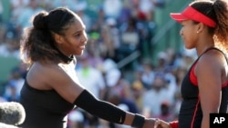 FILE - Naomi Osaka, right, of Japan, shakes hands with Serena Williams after winning their match at the Miami Open tennis tournament, Wednesday, March 21, 2018, in Key Biscayne, Fla. Osaka won 6-3, 6-2. The two will meet again in the 2018 U.S. Open Championship final. (AP Photo/Lynne Sladky)