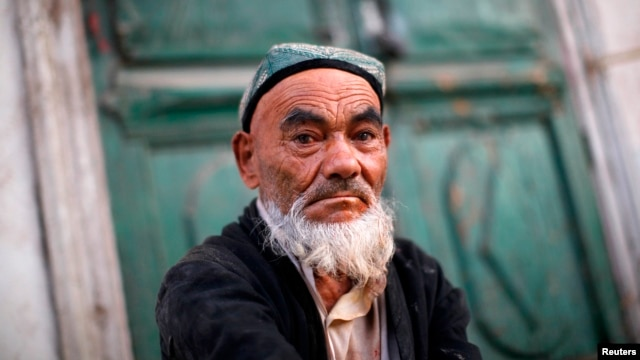 FILE - An Uighur man sits at a street market in Kashgar, Xinjiang province.