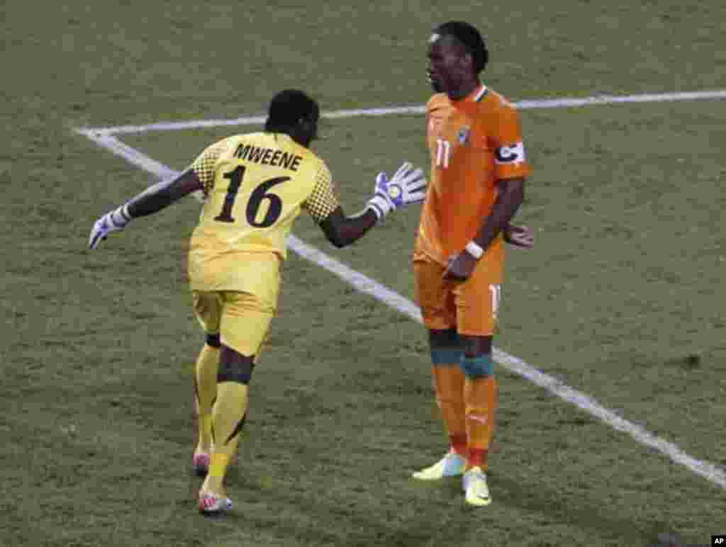 Zambia's goalkeeper Kennedy Mweene (L) reacts after Ivory Coast's Dider Drogba missed his penalty during their African Nations Cup final soccer match at the Stade De L'Amitie Stadium in Libreville February 12, 2012.
