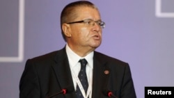 FILE - Russian Economic Development Minister Alexei Ulyukayev delivers his speech during the plenary session of the ninth WTO Ministerial Conference in Bali, Indonesia, 4, 2013.
