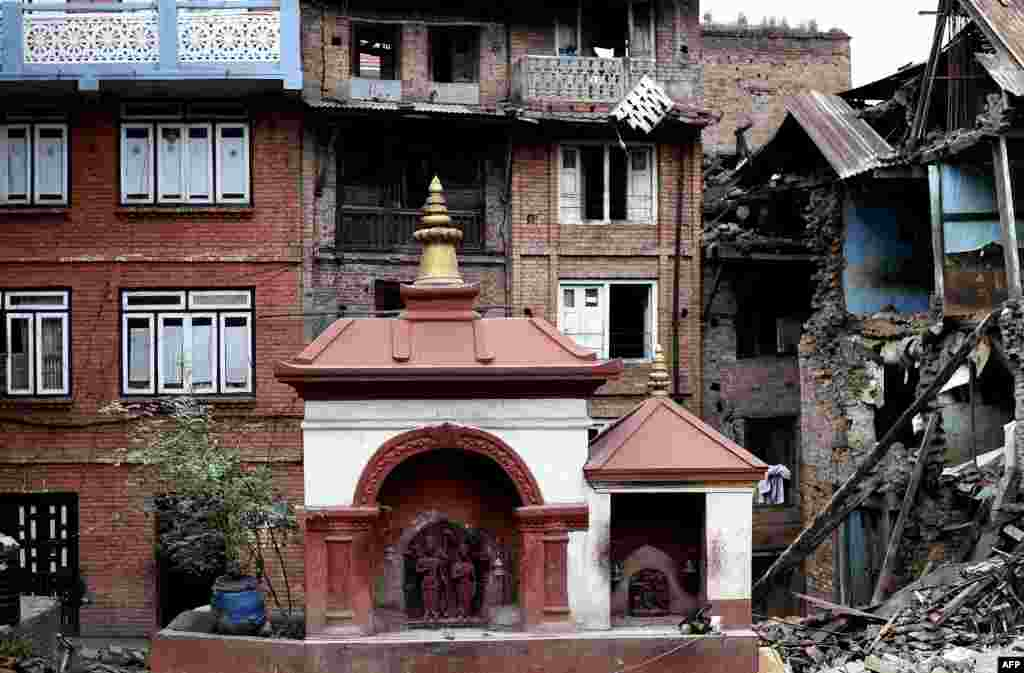A small temple structure is seen undamaged amidst rubble of damaged buildings at the heritage town of Bhaktapur, following a 7.8 magnitude earthquake which struck the Himalayan nation of Nepal on April 25.