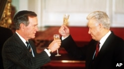 FILE - Then-Russian President Boris Yeltsin toasting with then-U. S. President George H. W. Bush after they signed the START II treaty in Moscow, Jan. 3, 1993.