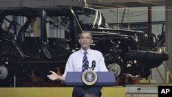 President Barack Obama speaks at Chrysler Group's Toledo Assembly complex in front of a Jeep Wrangler, in Toledo, Ohio, June 3, 2011