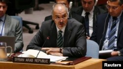 FILE - Syrian Ambassador to the U.N. Bashar Ja'afari speaks during a United Nations Security Council meeting at U.N. headquarters in New York, Sept. 19, 2014.
