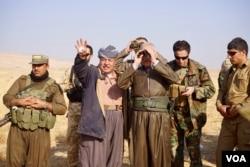 Kurdish notables including family members of Iraqi Kurdistan President Masoud Barzani watched the battle for Bashiqa unfold. (J. Dettmer/VOA)