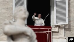 Pope Francis waves to faithful during the Angelus noon prayer in St. Peter's Square, at the Vatican, Sunday, Dec. 16, 2018.