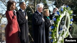 President Barack Obama (2nd L), first lady Michelle Obama (L), former President Bill Clinton (3rd L) and Hillary Clinton participate in a wreath-laying in honor of assassinated U.S. President John F. Kennedy at Arlington National Cemetery, near Washington D.C., Nov. 20, 2013.