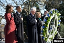 President Barack Obama (2nd L), first lady Michelle Obama (L), former President Bill Clinton (3rd L) and Hillary Clinton participate in a wreath laying in honor of assassinated President John F. Kennedy at Arlington National Cemetery, near Washington, D.C., Nov. 20, 2013.