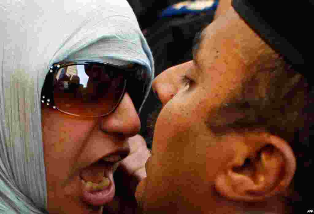 January 26: An anti-government protester clashes with a policeman in Cairo. (Reuters/Amr Abdallah Dalsh)