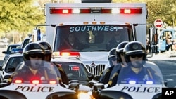Tucson police escort the ambulance of U.S. Rep. Gabrielle Giffords, as she is being moved to Memorial Hermann Hospital in Houston for rehabilitation, 21 Jan 2011