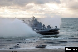 FILE - A military vessel is seen during the joint war games Zapad-2013 (West-2013), at the Khmelevka range on Russia's Baltic Sea in the Kaliningrad Region, Sept. 26, 2013. The Zapad 2017 exercises are set for September.