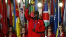 Men's marathon gold medallist Stephen Kiprotich of Uganda marches into closing ceremony of the London 2012 Olympic Games at the Olympic Stadium, August 12, 2012.
