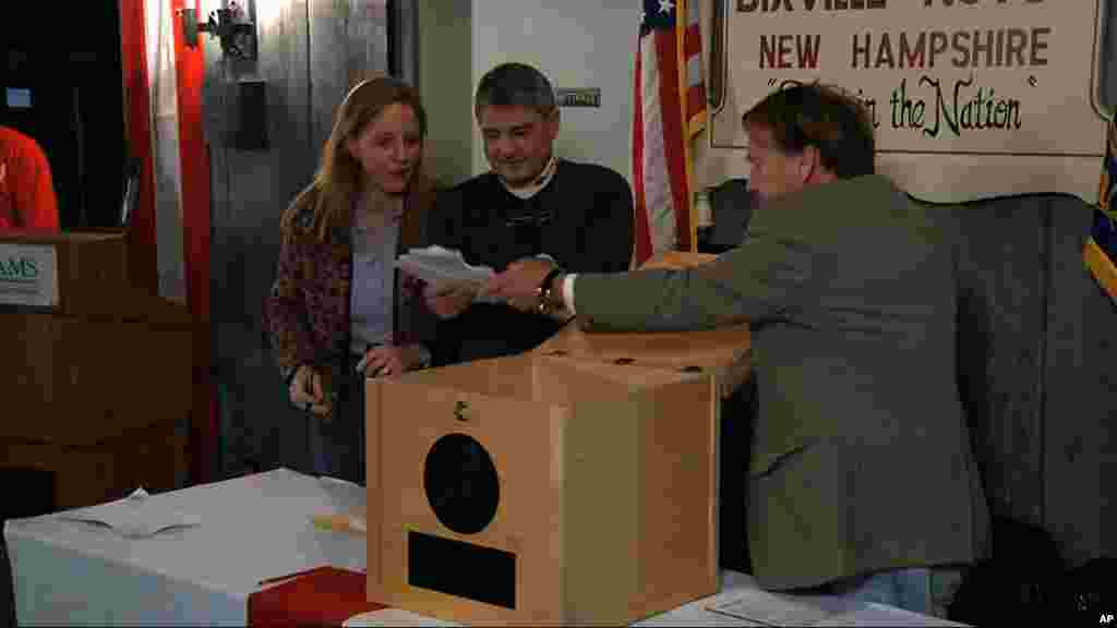 Ballots are removed from the ballot box to be counted in Dixville Notch, New Hampshire, November 6, 2012, as they cast the first Election Day votes in the nation.