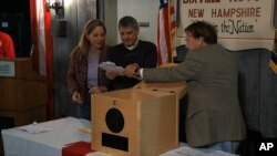 Ballots are removed from the ballot box to be counted in Dixville Notch, N.H., Nov. 6, 2012, as they cast the first Election Day votes in the nation.