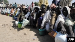 FILE - Internally displaced persons wait to be served with food at Dikwa camp, in northeast Nigeria's Borno state, Feb. 2, 2016. More than 5.1 million people are severely food insecure in parts of Borno, Adamawa and Yobe states in northeastern Nigeria.