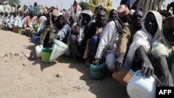 FILE - Internally displaced persons wait to be served with food at Dikwa camp, in northeast Nigeria's Borno state, Feb. 2, 2016. The U.N is hoping to raise $1 billion to meet the needs of nearly seven million victims of the Boko Haram insurgency in northeast Nigeria.