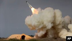 FILE - A long-range S-200 missile is fired in a military drill in the port city of Bushehr, on the northern coast of Persian Gulf, Iran, Dec. 29, 2016.