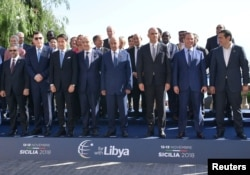 Heads of delegations pose for a photo during the second day of the international conference on Libya in Palermo, Italy, Nov. 13, 2018.